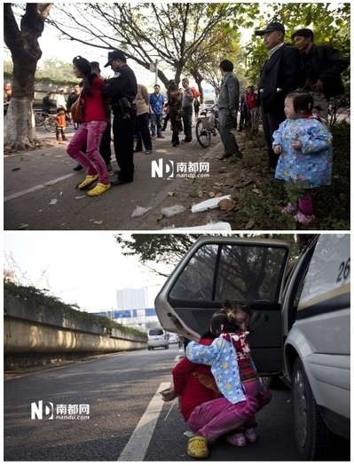 城管將女小販帶走,孩子受驚嚇大哭不已,由於雙手被反銬,女小販無法擁抱受到驚嚇的孩子。(網絡圖片)