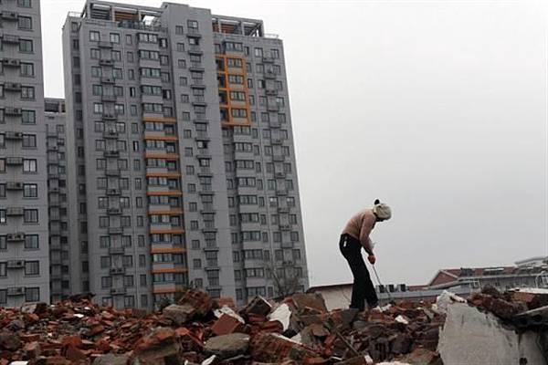 內部消息稱,日前北京已禁止黨員幹部拋售房產。評論稱,中國樓市面臨崩盤。(Getty Images)2016-10