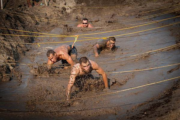 US_Navy_110813-N-XS652-351_Runners_navigate_an_obstacle_during_the_11th_annual_Armed_Services_YMCA_Mud_Run_at_Joint_Expeditionary_Base_Little_Creek