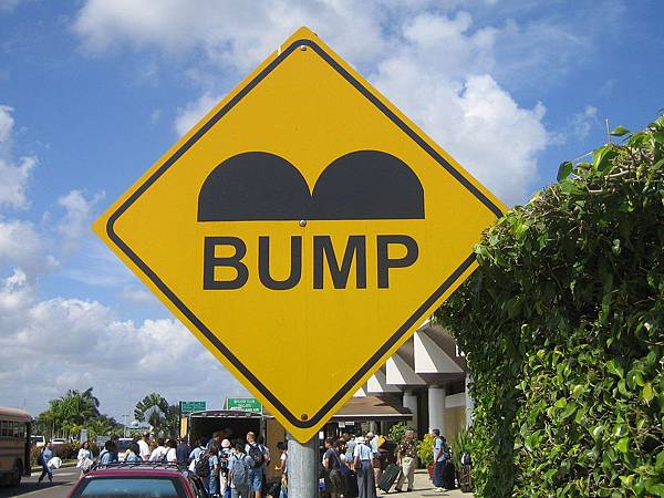 1280px-Belize_Speed_Bump_Sign
