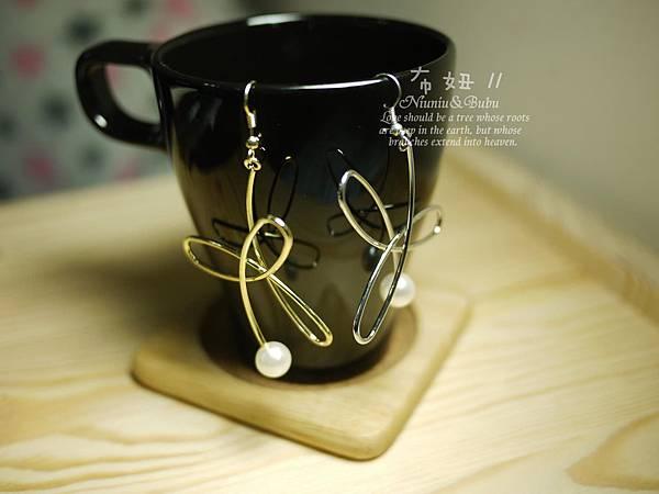 簡單又華麗~手作感纏繞珍珠花朵耳環  58元
