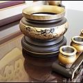檜木雕刻神聯作品-招財進寶(千百產品通全球/億萬盈利冠五洲)