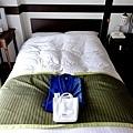 15城倉旅館房間單人床.jpg