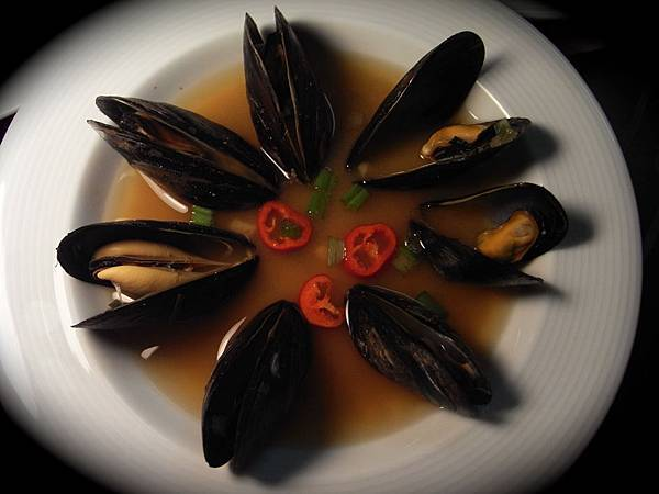 White miso soup with steamed mussels
