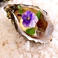 Freshly shucked oyster in a spice marinade, grilled and served with kokum ice cream.jpg