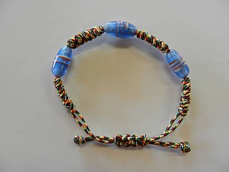 Feb172012 five-color thread bracelet with blue beads