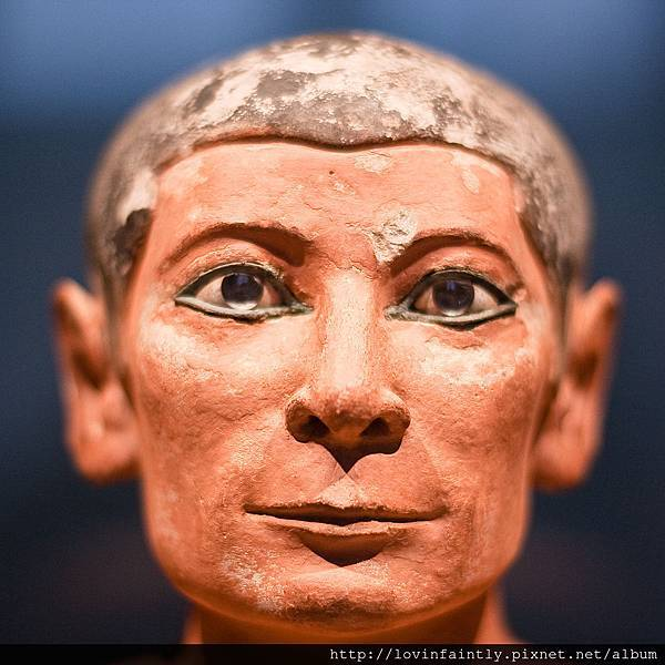 1024px-Seated_Scribe_Facial_Close-Up