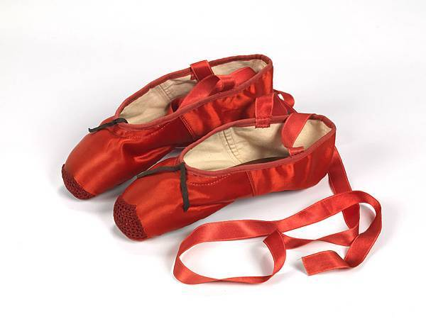 4._Freed_of_London_founded_in_1929_red_ballet_shoes_made_for_Victoria_Page_Moira_Shearer_in_The_Red_Shoes_1948_silk_satin_braid_and_leather_England_1948_Northampton_Museums_and_Art_Gallery.JPG