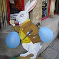 43. Peter Rabbit in front of Alice's shop