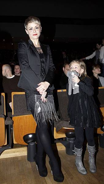 Maksim's wife Ana and daughter Leeloo.jpg