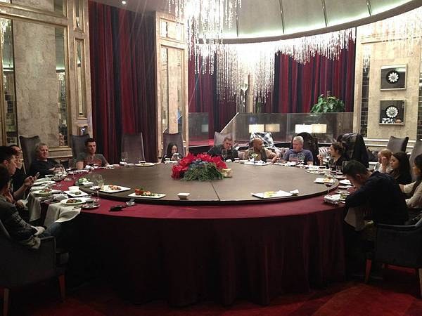 Having dinner with band and the crew after the show in Tianjin