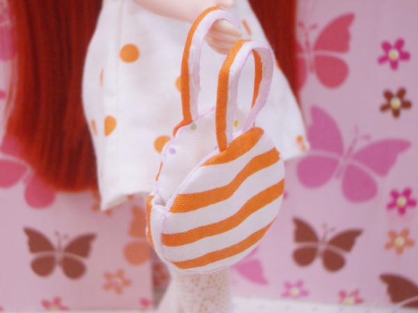 小布點拼接洋裝橘扁包1.jpg