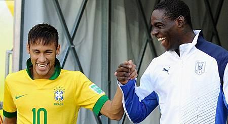 Neymar of Brazil and Mario Balotelli of Italy