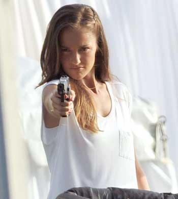 minka-kelly-gun-charlies-angels-set-07212011-lead.jpg