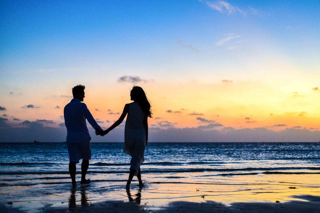 man-and-woman-holding-hands-walking-on-seashore-during-1024960.jpg