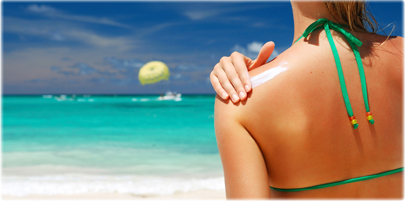 thinkstock_rf_photo_of_woman_applying_lotion_beach