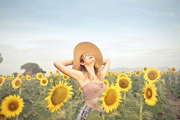 woman-standing-on-sunflower-field-3764579.jpg