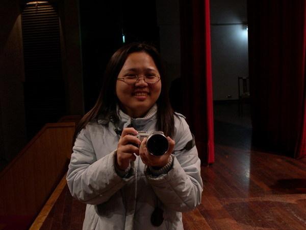 拿著相機的我