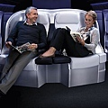 Premium Economy Couple Stretched Out.jpg