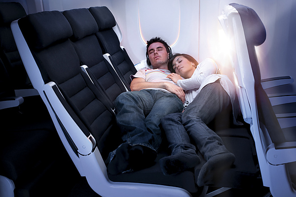 Economy Skycouch Young Couple Stretched Out.jpg