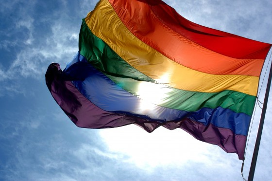 Rainbow_flag_and_blue_skies-560x372