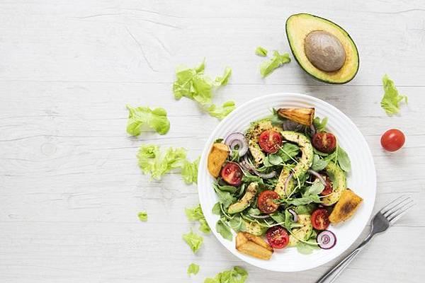 vegan-salad-with-avocado-white-wooden-table_23-2148305802