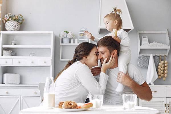 family-sitting-kitchen-have-breakfast_1157-28714