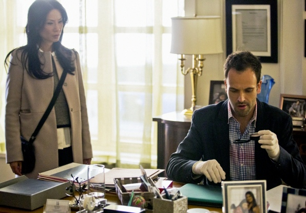 Jonny Lee Miller as Sherlock Holmes and Lucy Liu as Joan Watson in CBS Elementary.jpg