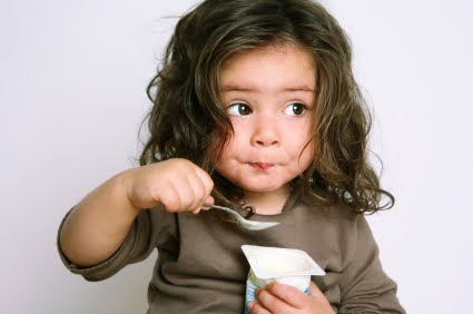 girl eating yogurt.jpg