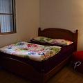 Ki 厝 - 二樓雙人大床房的床