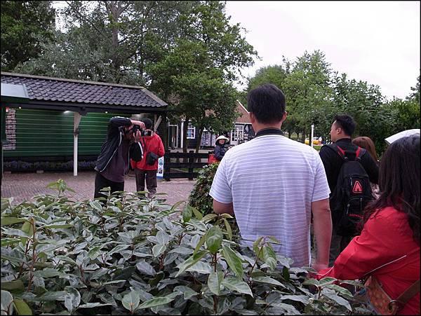 風車村門口攝影師拍照