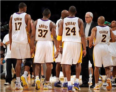 Lakers starters surround Phil Jackson.JPG