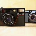 Nikon L35AF, and a Canon AF35M in the back