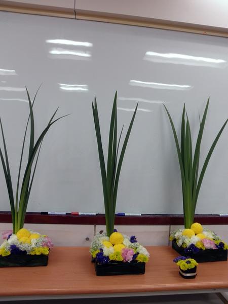2009會場佈置班-餐桌花設計 (2).JPG