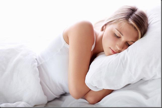 bigstock-Young-girl-sleeping-in-bed-38752036