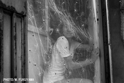 Little girl behind the silk curtain.jpg