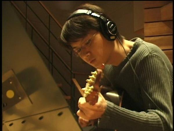 Fukuyama plays guitar.jpg