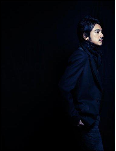 TK in black-side photo.jpg