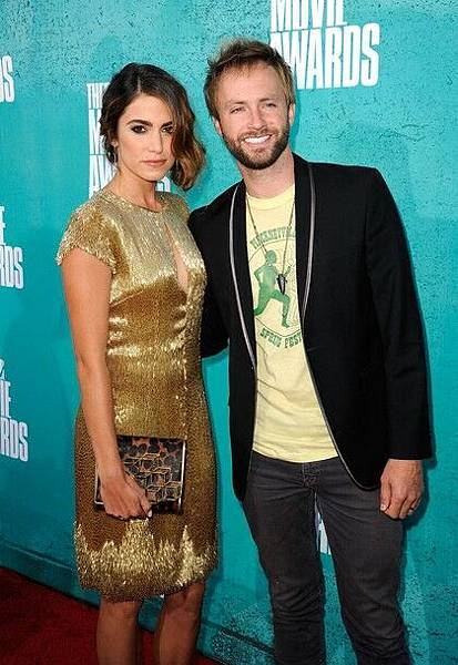 Nikki Reed (Rosalie Hale) and husband Paul Mcdonald attend the 2012 MTV Movie Awards
