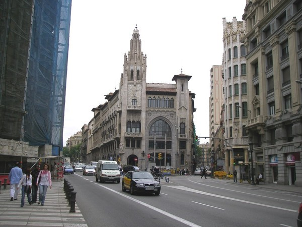 Building and the Urqinaona train Station.jpg