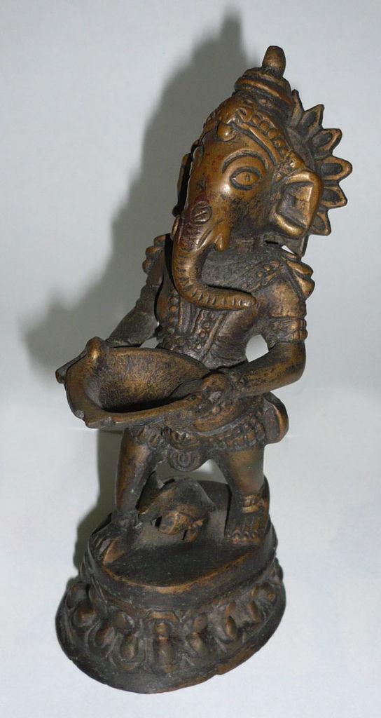 銅雕象頭財神 (鄭松維 攝)