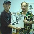 畫家舒曾子(圖右)與本報總主筆攝於台北市杭州南路畫室