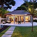 Extraordinary one-bedroom villa garden at dusk