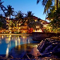 The expansive lagoon and lush tropical garden at dust