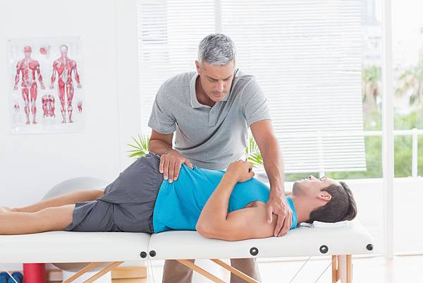 bigstock-physical-therapist-stretching-lower-back-man-85571219.jpg