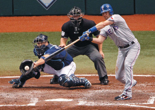 2010 Playoff Rays G2 Michael Young check swing.jpg
