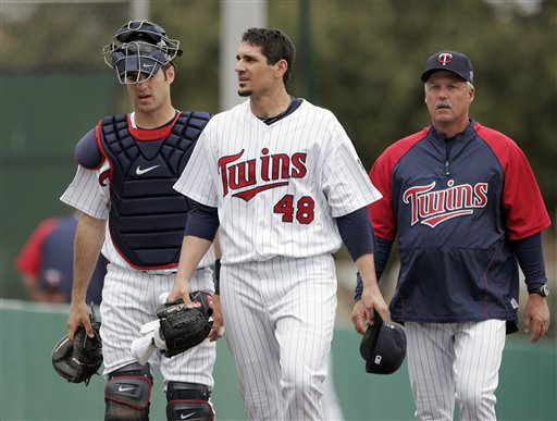 Joe Mauer and Carl Pavano.jpg
