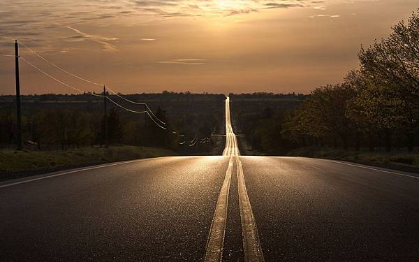 6976877-sunset-straight-road