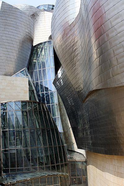 2.399px-The museum is clad in glass, titanium, and limestone