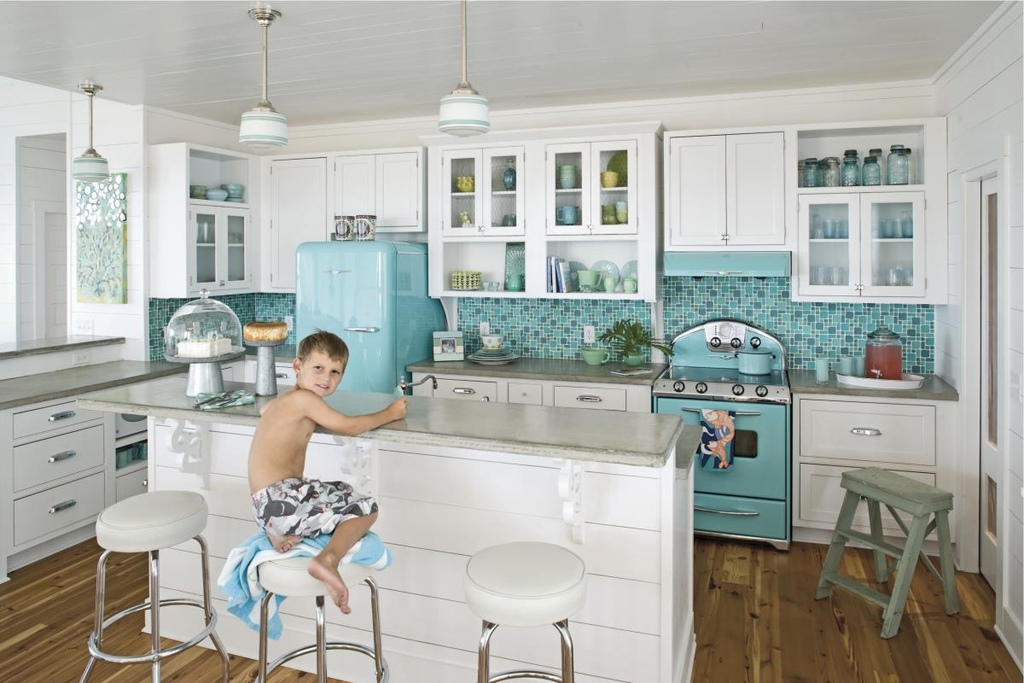 Bright-kitchen-with-a-retro-fridge-stove-and-a-matching-backdrop.jpeg